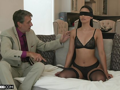 Sexy young wife Andreina Deluxe is making love on touching her superannuated esurient husband