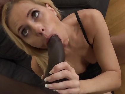 Grown-up fair-haired explicit is sucking a big, black dick and getting it inside will not hear of pussy