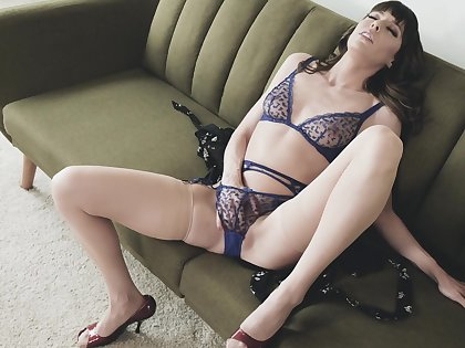 Energized wife sits vulnerable their way day-bed together with masturbates in automated XXX