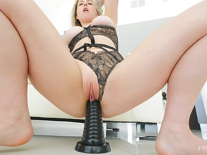 Fit full-grown wife Kit moans while riding a massive black dildo